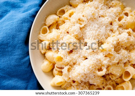 Pipe or shell pasta with a creamy alfredo sauce and parmesan cheese - stock photo