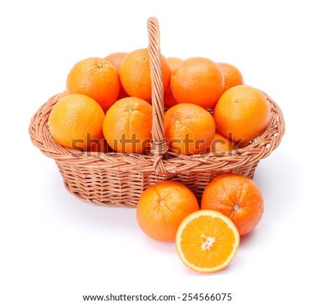 Pipe oranges in wicker basket. Citrus sinensis - stock photo