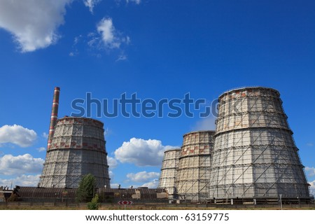 Pipe thermal power plant against the blue sky - stock photo