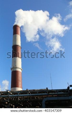 Pipe with dense smoke. - stock photo
