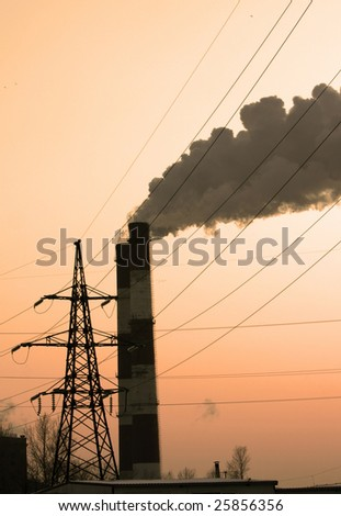 Pipe with smoke and line of electricity transmission