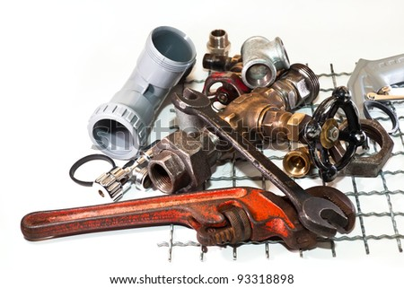 pipe wrench, taps for water and plumbing tools for the metal lattice - stock photo