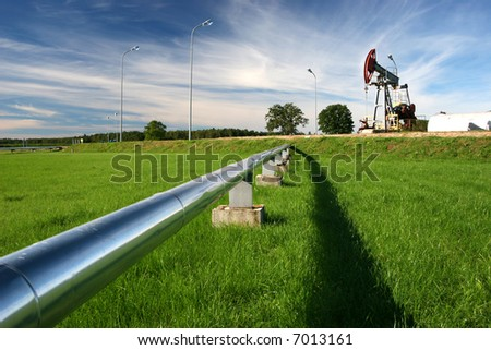 Pipeline and oil pump - stock photo