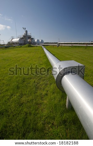 pipeline and storage tanks - stock photo