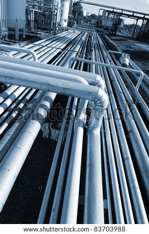 pipeline construction leading to main refinery, deep blue toning concept