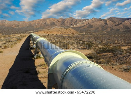 Pipeline in the Mojave Desert. - stock photo