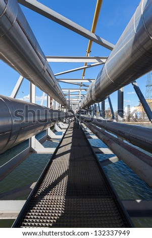 Pipeline installation over the water - stock photo