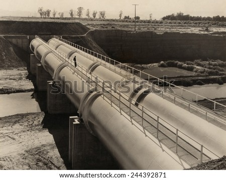 Pipeline of California's All-American Canal carries water to the Imperial Valley from the Colorado River fed reservoir behind the Imperial Dam. Public Works Projects of the 1930's New Deal. - stock photo