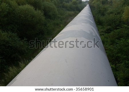 Pipeline, running through the forest naegu river - stock photo