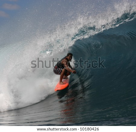 Pipeline surfer Tamayo Perry - stock photo