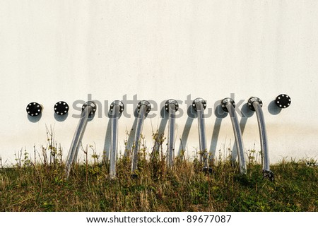 Pipeline, tubes on wall - stock photo