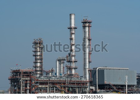 pipelines and towers of oil and gas refinery petrochemical factory - stock photo