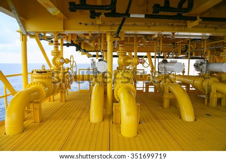 pipelines on oil and gas platform for production, Oil and gas process and control by automation system, Operator control product in oil and gas industry.  - stock photo