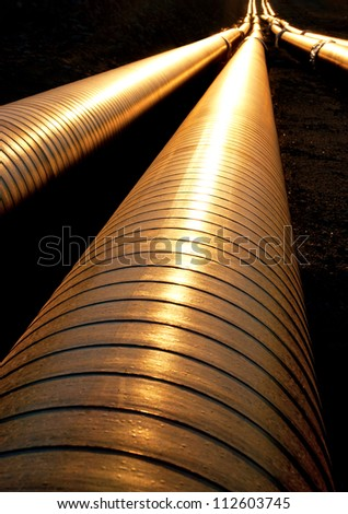 Pipelines ready to dig down, reflecting the evening light - stock photo