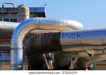 Pipes and tubes at a power plant - stock photo