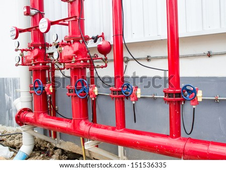 Pipes and Valves Inside Industrial Facility - stock photo