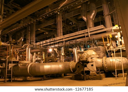 Pipes, machinery, tubes and pumps at a power plant - stock photo