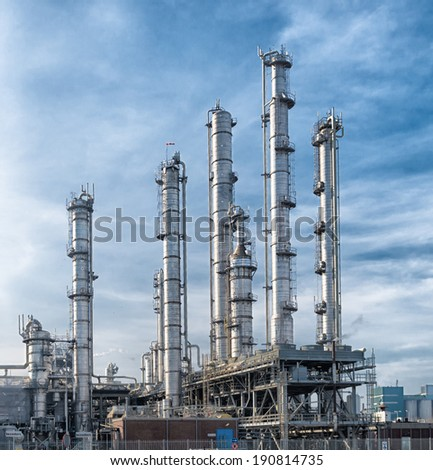 pipes of a petrochemical plant in the rotterdam harbor - stock photo