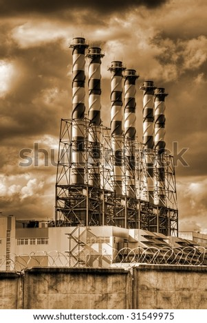 Pipes of factories in brown tone as industrial symbol - stock photo