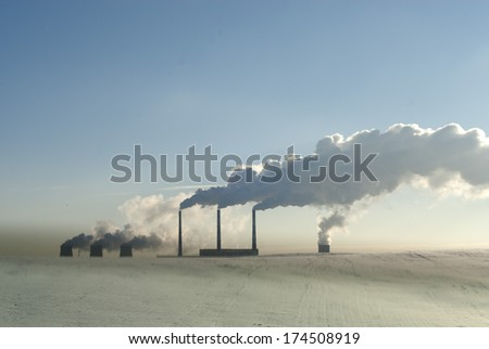 Pipes of the thermal power plant - stock photo