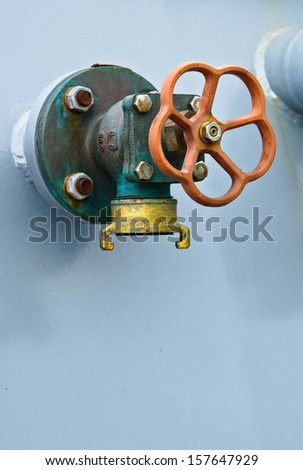 pipes on the deck of a ship - stock photo