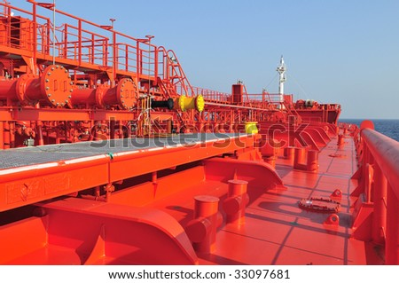 Pipes on the deck of the tanker crude oil ship - stock photo