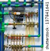 Pipes, pumps, valves and thermostats of heating system - stock photo