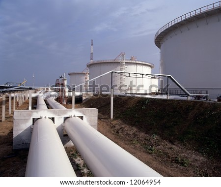 Pipes Transporting Oil To Storage Tanks - stock photo