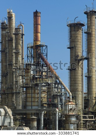 Pipes, tubes and heavy industry machinery at a blue sky - stock photo