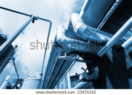 Pipes, tubes, cables and equipment at a power plant - stock photo