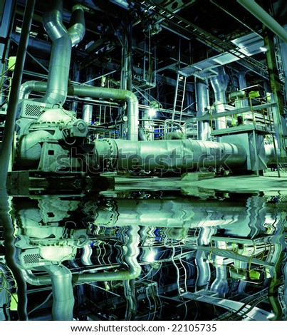 Pipes, tubes, machinery and steam turbine at a power plant with reflection
