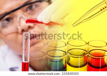 Pipette adding red fluid to test tubes,laboratory concept
