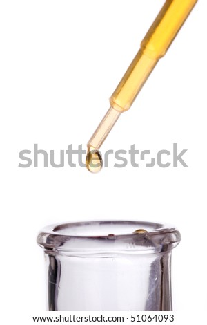 Pipette dropping liquid into a flask - stock photo