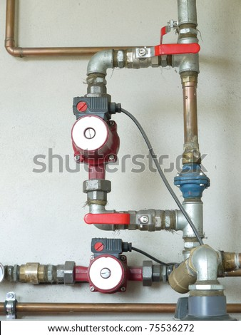Piping and valving of household central heating system - stock photo