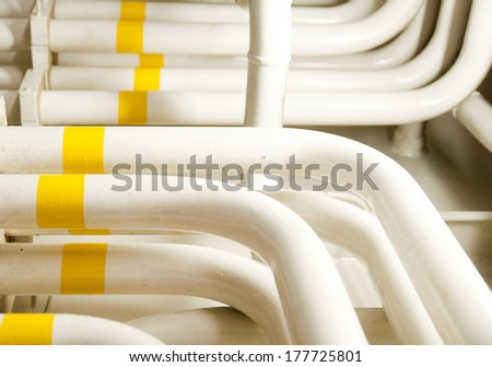 Piping Engine Room Spaces on a modern vessel - engineering interior including pipes - stock photo