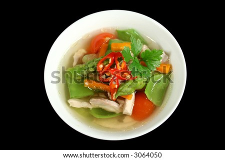Piping hot low carb chicken and vegetable soup ready to serve. - stock photo