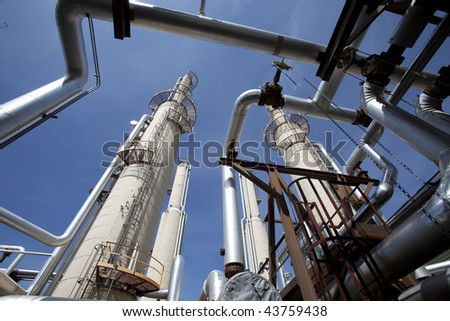 Piping in a gas compressor plant - stock photo