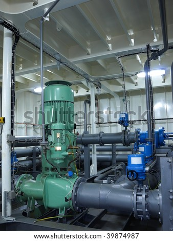 Piping system and pump. - stock photo