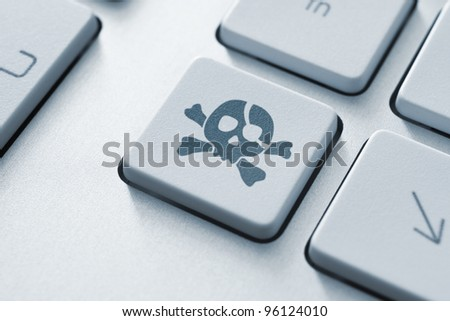 Piracy attack key on the keyboard. Toned Image. - stock photo