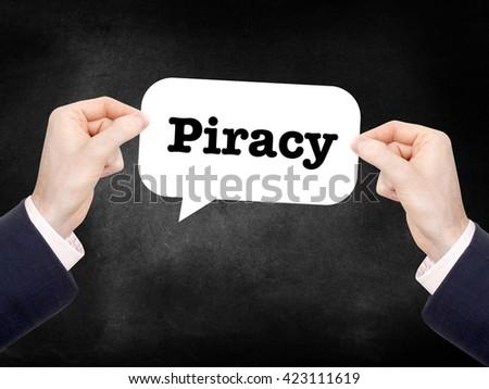 Piracy written in a speechbubble - stock photo