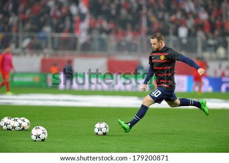 PIRAEUS, GREECE -FEB. 25. Manchester United's English forward Wayne Rooney warms up before Champions League football match Olympiakos vs Manchester United at Karaiskaki Stadium ,February 25, 2014 - stock photo