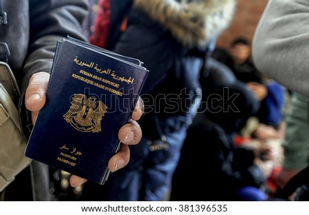 Piraeus, Greece - February 23, 2016: Migrants and refugees arrive at the port of Piraeus. Syrians and Iraqis to continue their journey towards the borders after their arrival to the port   - stock photo