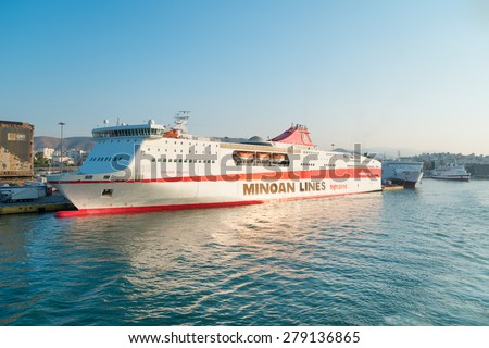 "PIRAEUS, GREECE - JULY 22: Highspeed ferry ""Knossos Palace"" of Minoan Lines docking at the port of Piraeus, Greece on July 22, 2014. The ferry line connects mainland Piraeus with Heraklion, Crete. - stock photo"