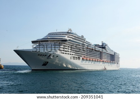 Piraeus, Greece - July, 24, 2014: Msc Fantasia is a cruise ship of Msc Cruises. Has built in 2008,Tonnage 137,936 GT, Length 333.3 m, Passengers 3,900 and Crew 1,313 - stock photo