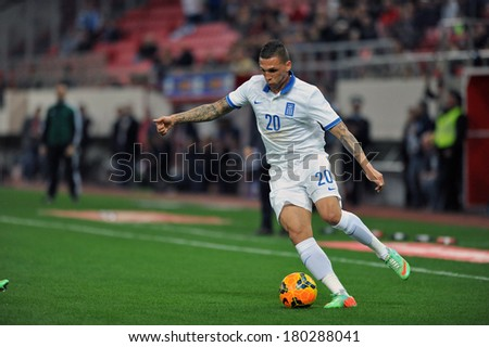 PIRAEUS GREECE MAR 05 Greece's Chose Cholebas, in action during a friendly match against South Korea (0-2 ) at Karaiskakis stadium in Piraeus port, near Athens, Wednesday, March 5, 2014