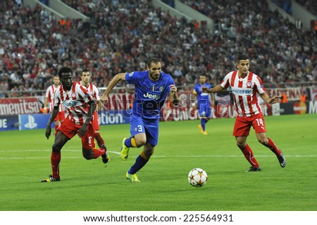 Piraeus, Greece Oct. 22, 2014.Juventus Giorgio Shiellini, with the ball, Elabdellaoui (14) right, and N`Dinga (8) left  during t the Champions League soccer match between Olympiakos vs Juventus (1-0) - stock photo