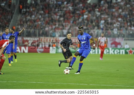 Piraeus, Greece Oct. 22, 2014.Juventus Paul Togba, with the ball, during t the Champions League football match between Olympiakos vs Juventus (1-0) at Karaiskaki Stadium in Piraeus - stock photo