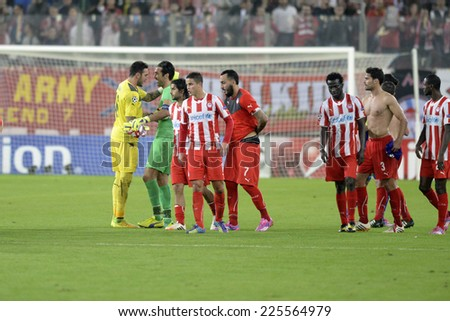 Piraeus,Greece Oct. 22, 2014. Olympiacos' goalkeeper Roberto, left, is congratulated by Juventus goalkeeper Gianluigi Buffon at the end of a Champions League soccer match Olympiakos vsJuventus,(0-1) - stock photo