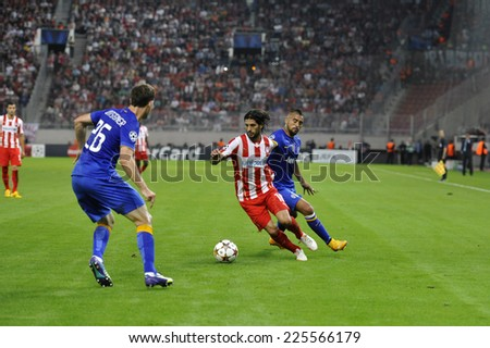 Piraeus,Greece Oct. 22, 2014. Olympiakos' Alejandro Dominguez, fights for the ball, next to Arturo Vital during the soccer match between Olympiakos and Juventus (1-0) at Karaiskaki Stadium in Piraeus - stock photo