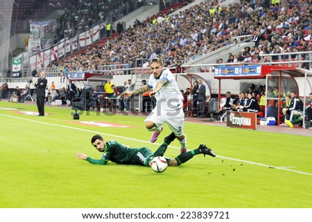 Piraeus, Greece October 14, 2014. Greece's Kostas Stafylidis with the ball and N. Ireland's Conor McLaughin during Euro 2016 qualifying soccer match between Greece and Northern Ireland.